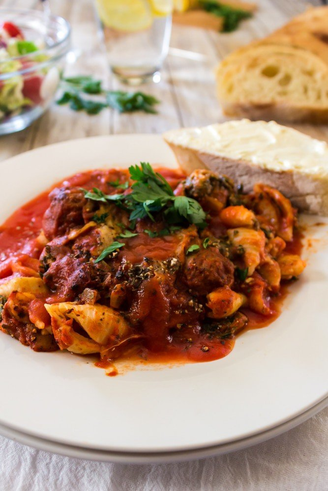 plate of skillet lasagna with bread.