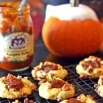 Pumpkin cookies on a cooling rack.