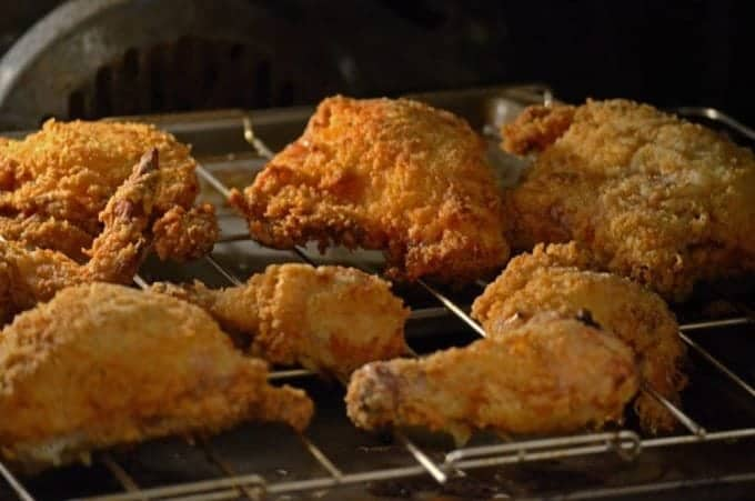 Butterrmilk oven fried chicken on an oven rack.