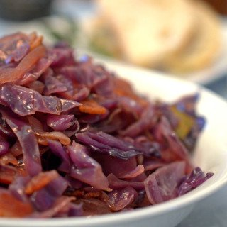 A close up of bowl of red cabbage and bacon