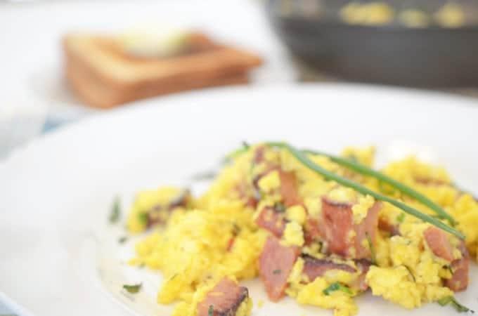 A close up of scrambled eggs and ham.
