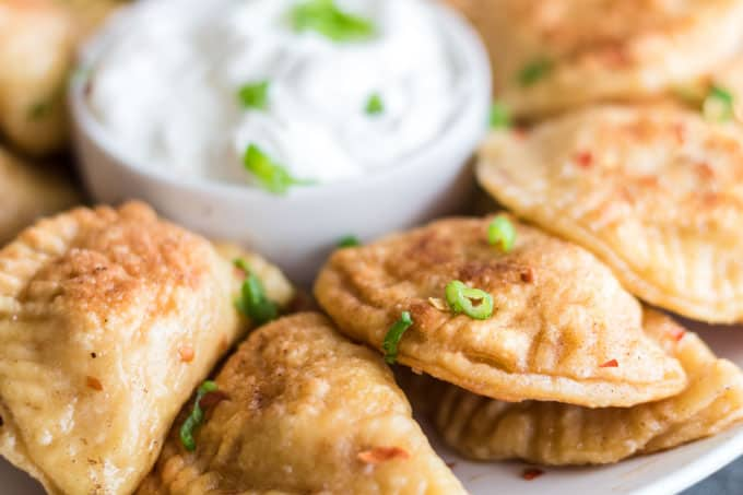 Platter or piergoi with chives and sour cream.