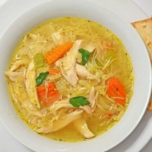 A bowl of Lipton chicken soup with added chicken