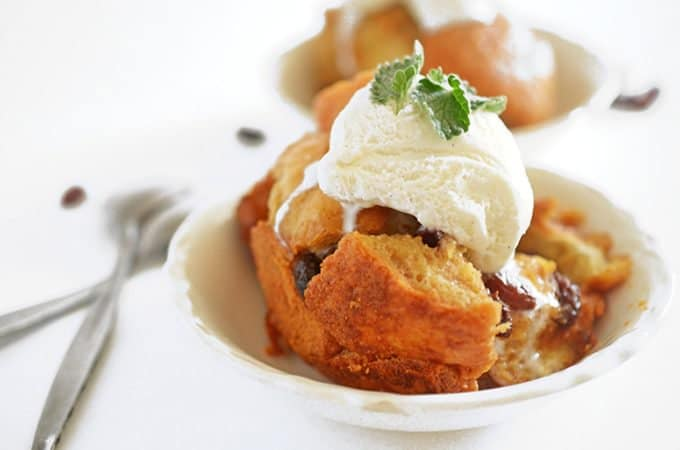 Slow cooker bread pudding topped with vanilla ice cream.