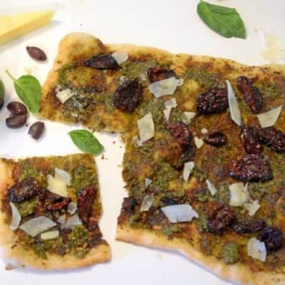 Pesto and Sun-Dried Tomato Pizza with Asiago Cheese