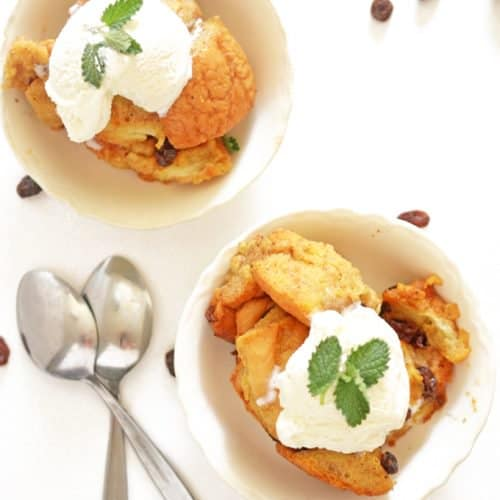 two bowls of slow cooker bread pudding with ice cream.
