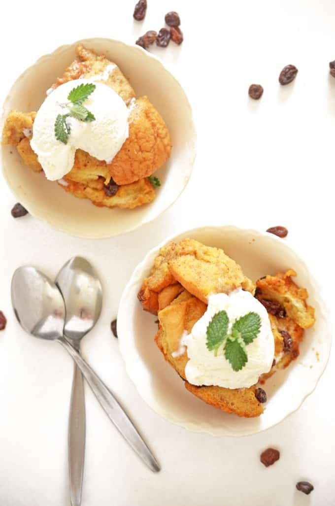 two dishes of slow cooker bread pudding with ice cream.