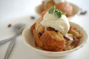 A close up of a bowl of bread pudding.