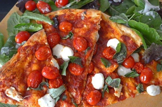 This easy Margherita pizza recipe goest together in about 30 minutes.