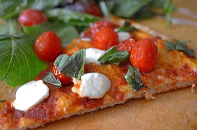 If you are asking how to make margherita pizza, this recipe from Platter Talk food blog will show you how!