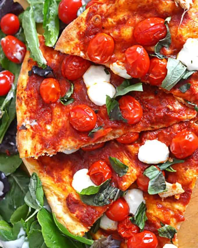 A plate of food, with Pizza and Tomato