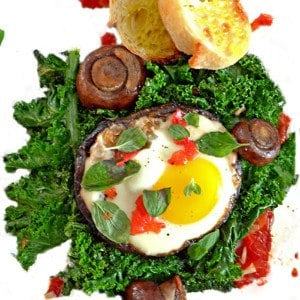 A sunny side-up egg on a bed of kale.