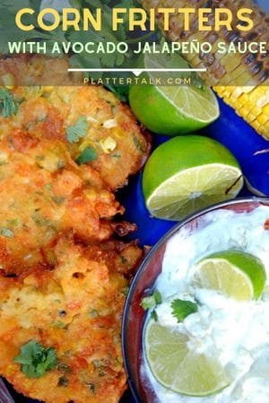 Corn fritters with bowl of avocado cream and limes.