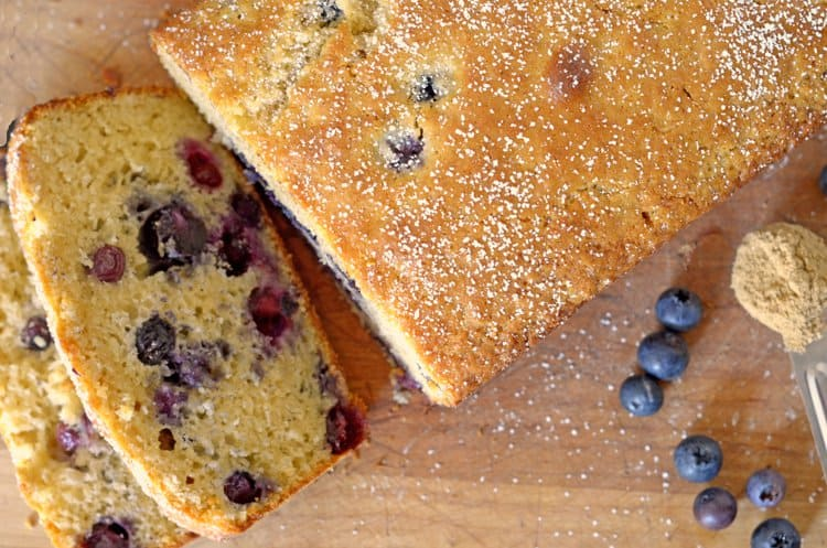 Top view of blueberry bread with two slices cut off.