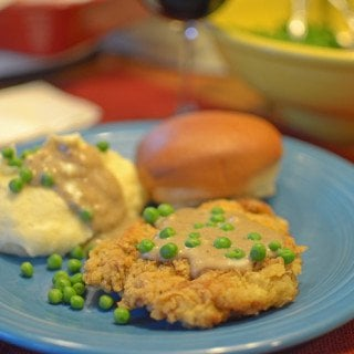 a plate of chicken-fried steak with gravy.