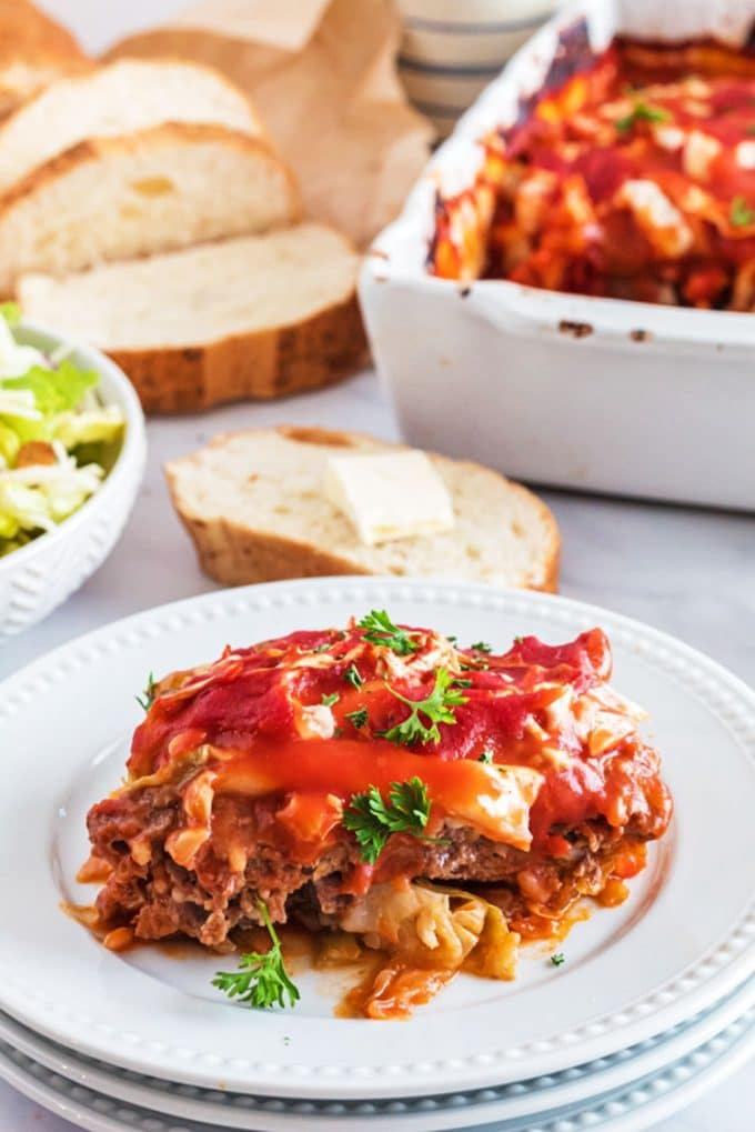 Seriving of stuffed cabbage roll casserole with bread and salad.