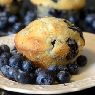A close up of a blueberry muffin.
