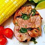 Grilled pork loin with ear of sweet corn.