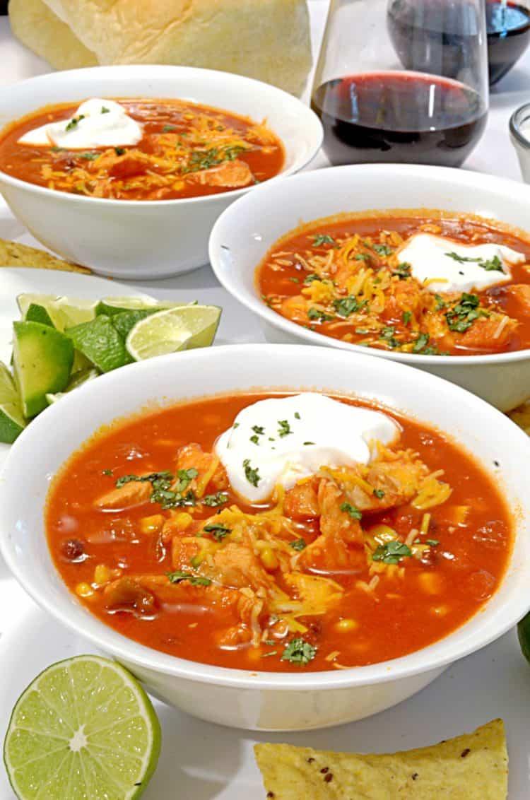 three bowls of soup.
