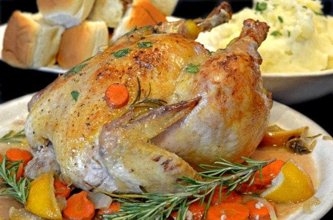 A roasted chicken with rosemary
