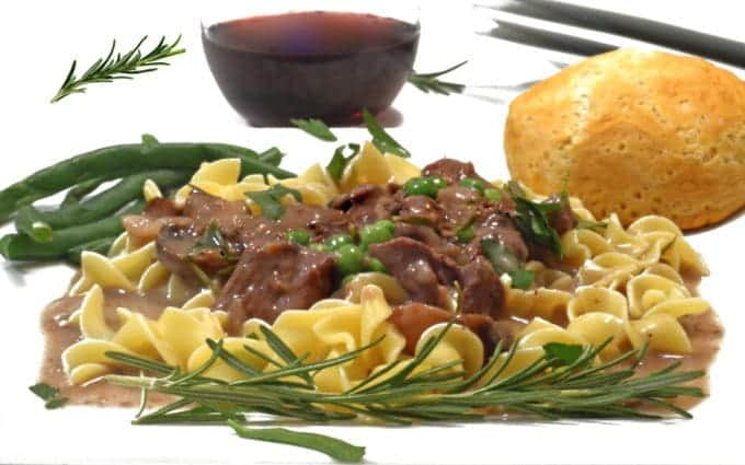 A plate of noodles with beef