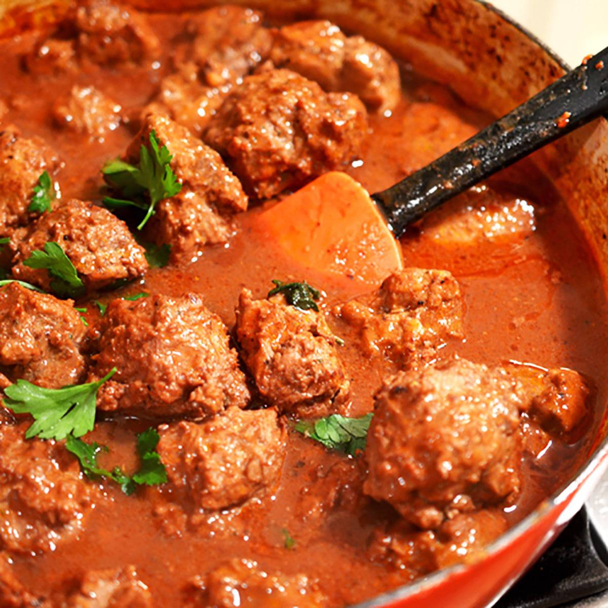 Pot of meatballs with red sauce