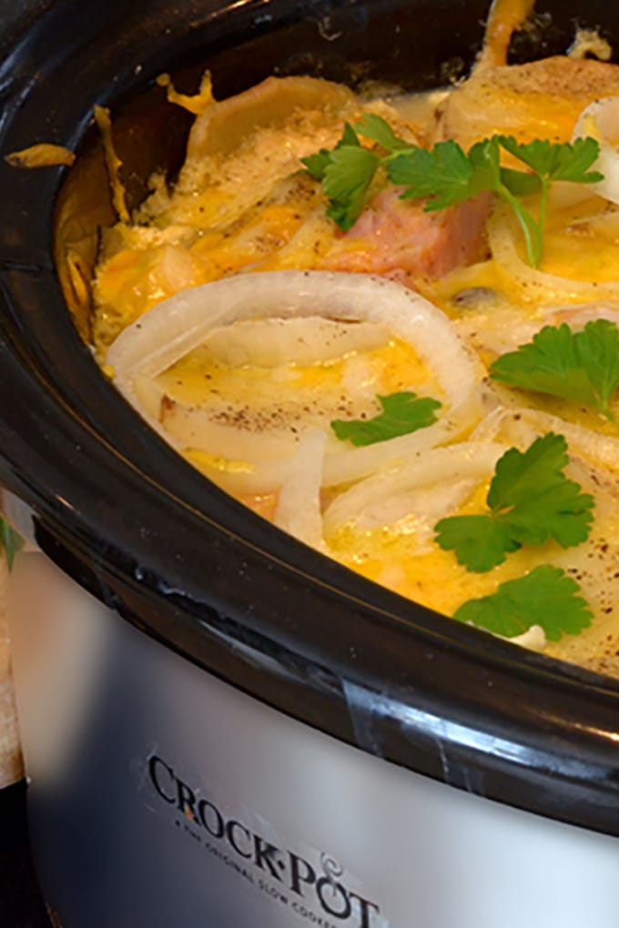 Crockpot full of scalloped potatoes and ham and cheese.