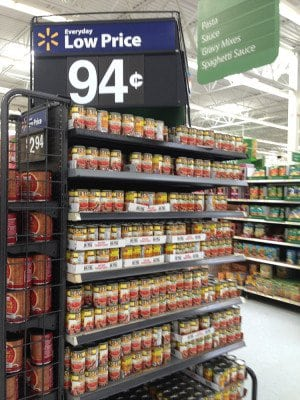 a store shelf of rotel tomatoes