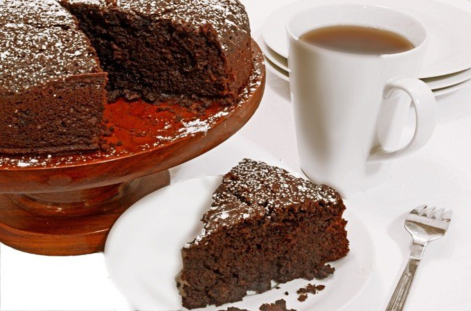 Slice of whiskey cake with cup of coffee.