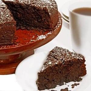 Slice of chocolate cake with a cup of coffee