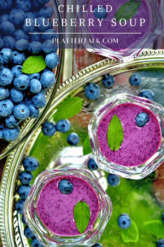 blueberry soup with mint garnish and fresh blueberries