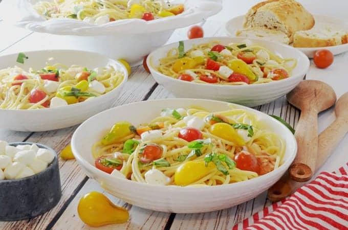 Spaghetti Caprese con Pomodori Marinati (Marinated Tomateos) from Platter Talk