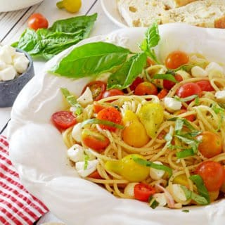 A bowl of pasta with tomatoes