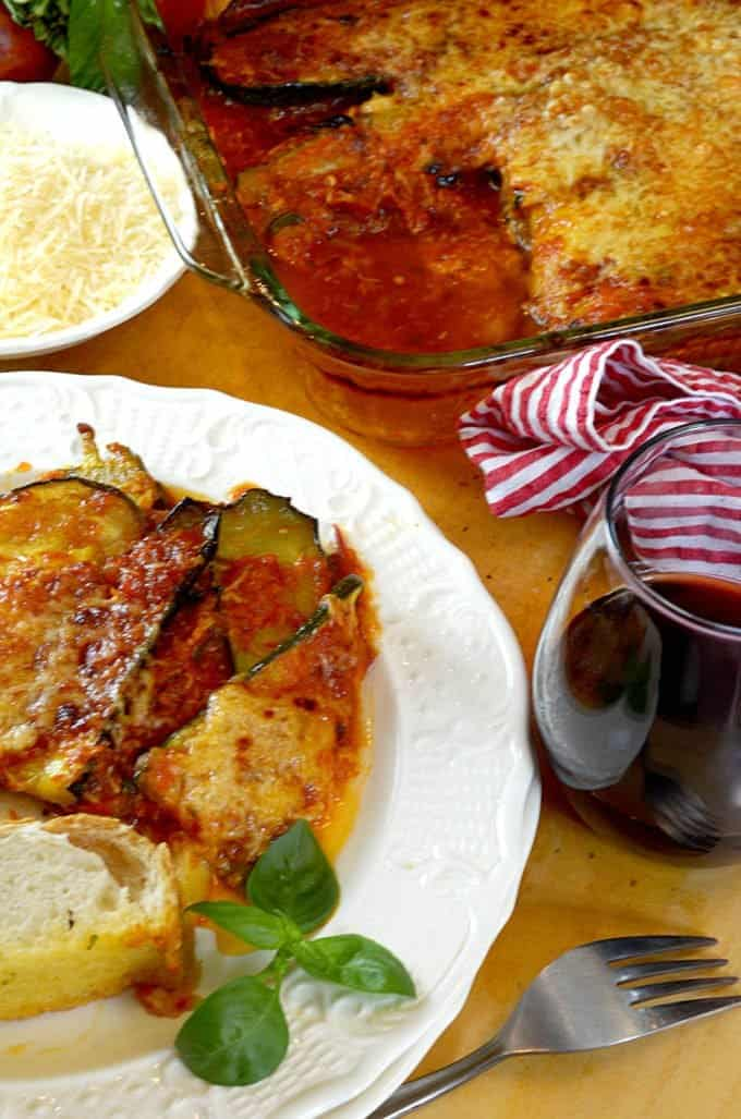 Baked Zucchini Parmesan with Homemade Tomato Sauce and red wine.