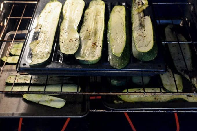 Zucchini being roasted ion oven.
