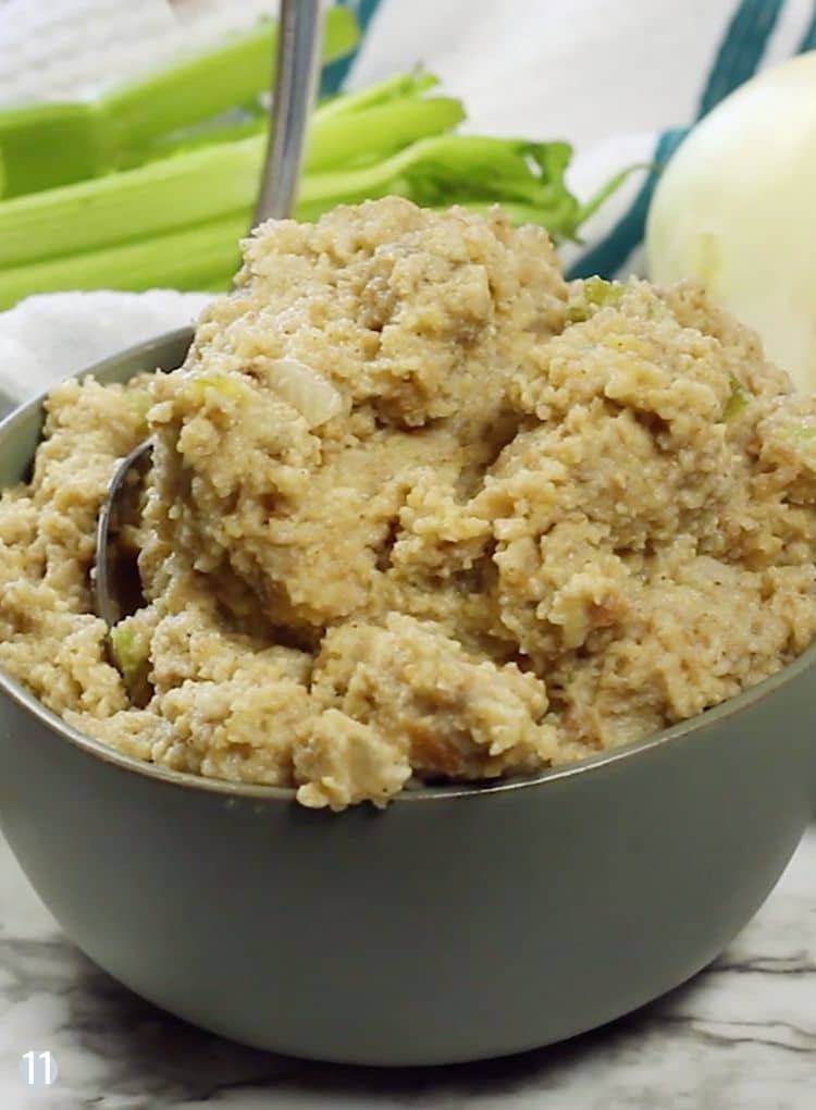 Serivng dish of souther cornbread dressing with spoon.
