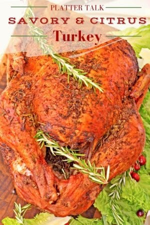 Whole roasted turkey garnished with rosemary sprigs