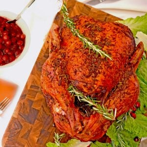 A roasted turkey on a cutting board
