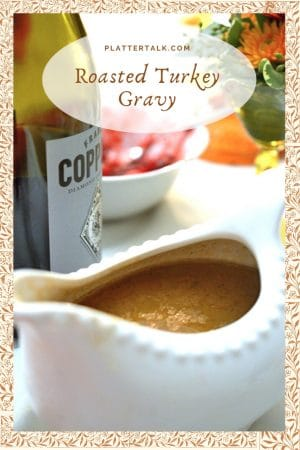 Serving Bowl of Turkey Gravy with a bottle of wine.