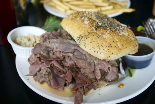 A close up Beef on weck on serving dish