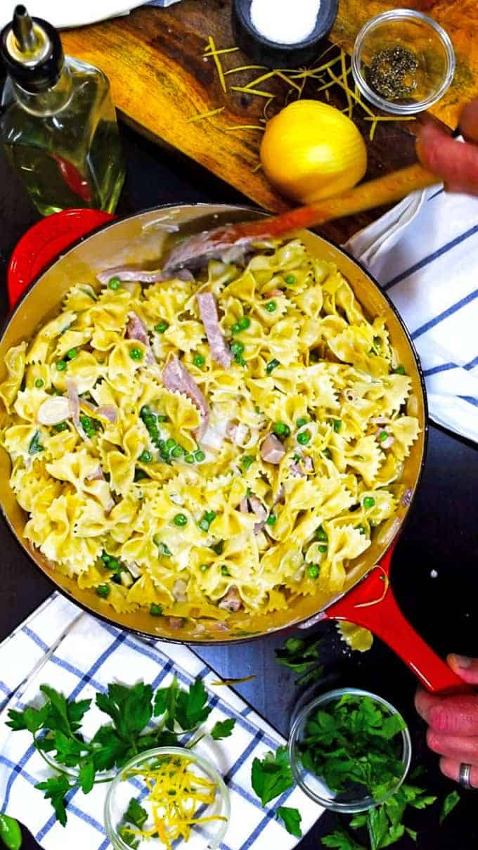 Creamy Pasta with Ham and Peas on the stove.