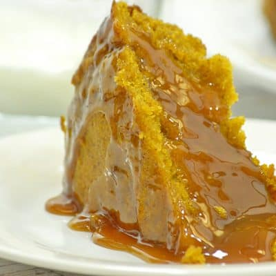 Slice of slow cooker pumpkin cake with caramel suace.
