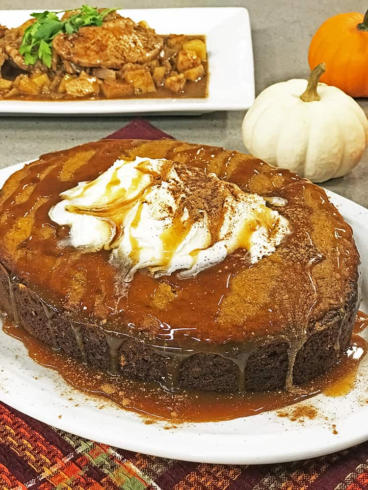 Pumpkin cake topped with whipped cream and caramel sauce