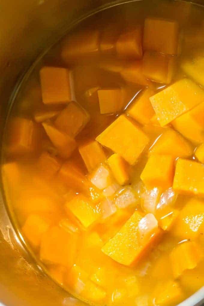 A pot of cut-up sweet potato