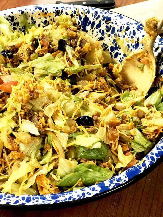 Close up dish of taco salad on table
