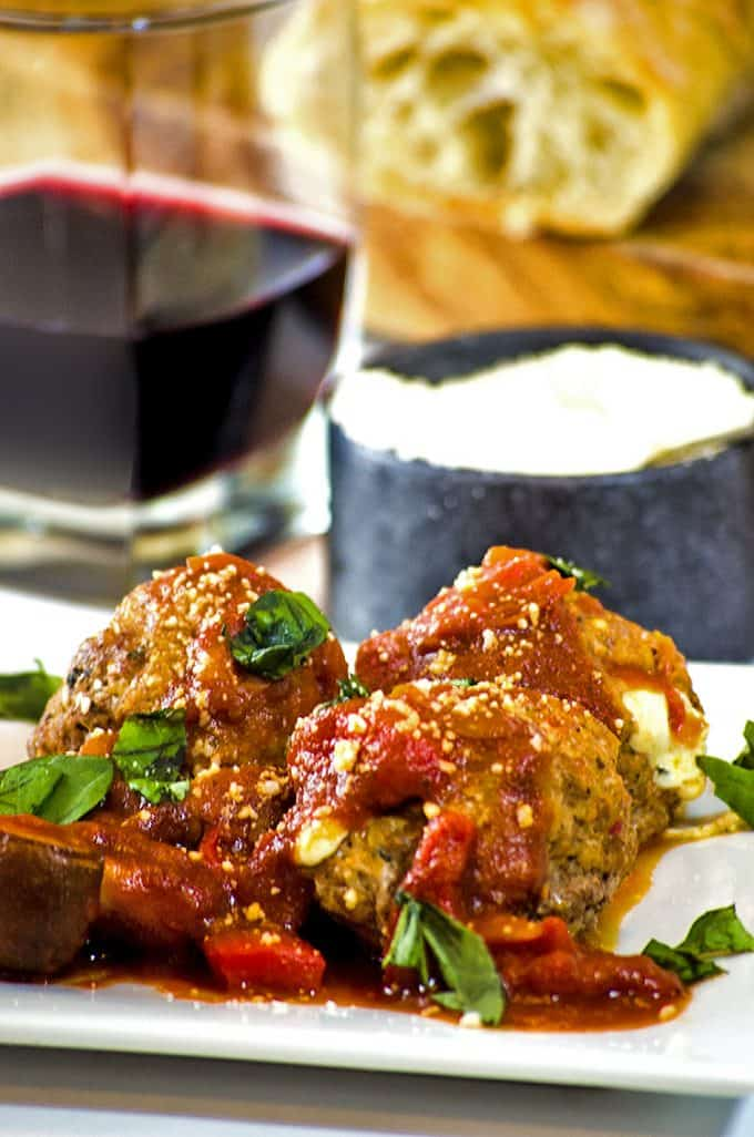 Sprinkle Parmesan cheese over pizza meatballs while they are still warm and before eating.