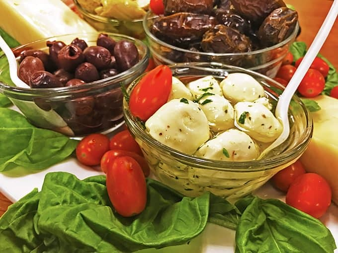 Antipasto platters usuallyu consist of Italian cheeses, fruits, and cured meats.