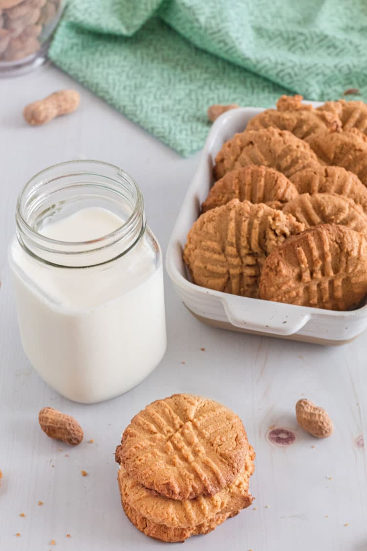 Pan of easy cookies with tall jug of white milk