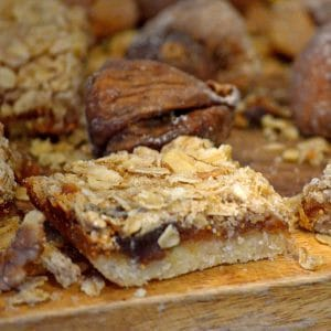 Fig bar on a cutting board with whole fig in background.