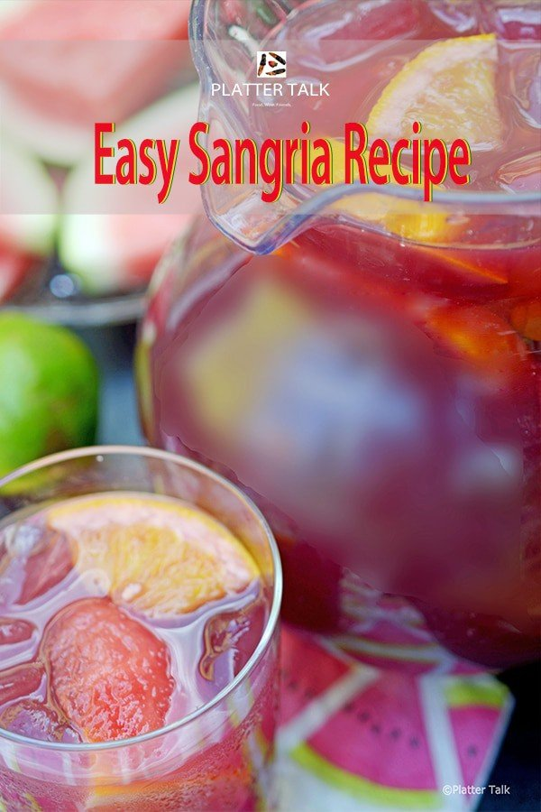 Pitcher of an easy sangria recipe with glass of red sangria.